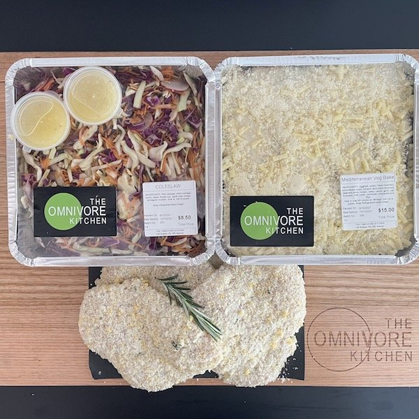 Meal combo with chicken schnitzel, coleslaw and vegetable bake
